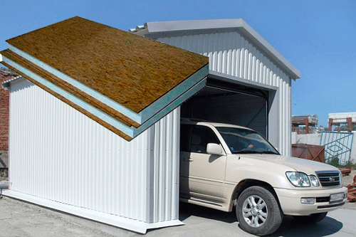 Сборно-разборный гараж из сэндвич-панелей, облицованных металлосайдингом.