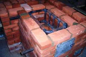 Теплообменник – «змеевик», встроенный в кирпичную печь.